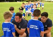 24 July 2019; Leinster players Bryan Byrne, left, and Jimmy O'Brien sign jerseys for participants during the Bank of Ireland Leinster Rugby Summer Camp in St Marys College RFC in Templeogue, Dublin. Photo by Seb Daly/Sportsfile