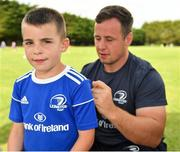24 July 2019; Leinster's Bryan Byrne signs a participant's jersey during the Bank of Ireland Leinster Rugby Summer Camp in St Marys College RFC in Templeogue, Dublin. Photo by Seb Daly/Sportsfile