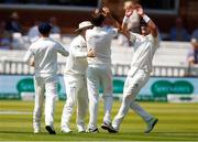 24 July 2019; Tim Murtagh, right, celebrates with team-mates Paul Stirling and Mark Adair after taking the wicket of Rory Burns of England with teammate Paul Stirling during day one of the Specsavers Test Match between Ireland and England at Lords Cricket Ground in London, England. Photo by Matt Impey/Sportsfile