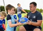 24 July 2019; Leinster's Bryan Byrne signs a participant's rugby ball during the Bank of Ireland Leinster Rugby Summer Camp in St Marys College RFC in Templeogue, Dublin. Photo by Seb Daly/Sportsfile