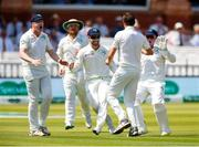 24 July 2019; Tim Murtagh, back to camera, celebrates with teammates, from left, Kevin O'Brien, Paul Stirling, Andrew Balbirnie and wicketkeeper Gary Wilson after taking the wicket of Jonny Bairstow of England during day one of the Specsavers Test Match between Ireland and England at Lords Cricket Ground in London, England. Photo by Matt Impey/Sportsfile