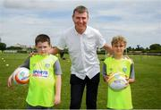 24 July 2019; Republic of Ireland U21 head coach Stephen Kenny poses for a photograph with participants during a FAI Festival of Football at Duleek FC in Duleek, Co Meath. Photo by Harry Murphy/Sportsfile