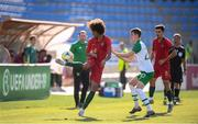 24 July 2019; Tomás Tavares of Portugal and Ciaran Brennan of Republic of Ireland during the 2019 UEFA U19 Championships semi-final match between Portugal and Republic of Ireland at Banants Stadium in Yerevan, Armenia. Photo by Stephen McCarthy/Sportsfile