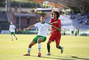 24 July 2019; Ali Reghba of Republic of Ireland and Tomás Tavares of Portugal during the 2019 UEFA U19 Championships semi-final match between Portugal and Republic of Ireland at Banants Stadium in Yerevan, Armenia. Photo by Stephen McCarthy/Sportsfile