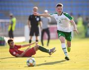 24 July 2019; Andy Lyons of Republic of Ireland and João Mário of Portugal during the 2019 UEFA U19 Championships semi-final match between Portugal and Republic of Ireland at Banants Stadium in Yerevan, Armenia. Photo by Stephen McCarthy/Sportsfile