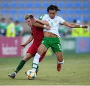 24 July 2019; Tyreik Wright of Republic of Ireland and Costinha of Portugal during the 2019 UEFA U19 Championships semi-final match between Portugal and Republic of Ireland at Banants Stadium in Yerevan, Armenia. Photo by Stephen McCarthy/Sportsfile