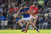 23 July 2019; Gearóid O'Connor of Tipperary in action against Robert Downey of Cork during the Bord Gais Energy Munster GAA Hurling Under 20 Championship Final match between Tipperary and Cork at Semple Stadium in Thurles, Co Tipperary. Photo by Sam Barnes/Sportsfile