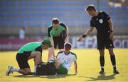 24 July 2019; Ciaran Brennan of Republic of Ireland is treated by Republic of Ireland team physiotherapist Michael Spillane, left, and Republic of Ireland team doctor Andrew Delany during the 2019 UEFA U19 Championships semi-final match between Portugal and Republic of Ireland at Banants Stadium in Yerevan, Armenia. Photo by Stephen McCarthy/Sportsfile