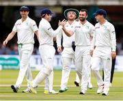 26 July 2019; Stuart Thompson of Ireland, 2nd from right, is congratulated by Ireland teammates after taking the final wicket of the England innings, that of Olly Stone during day three of the Specsavers Test Match between Ireland and England at Lords Cricket Ground in London, England. Photo by Matt Impey/Sportsfile