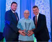 26 July 2019; Michael Ronan, Kinnegad Juniors AFC, Westmeath, is presented with his John Sherlock Services to Football award by Adrian Sherlock, son of John Sherlock, and Republic of Ireland U21 manager Stephen Kenny during the FAI Delegates Dinner and Communications Awards at Knightsbrook Hotel in Trim, Meath. Photo by Seb Daly/Sportsfile