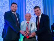 26 July 2019; Larry Kenny, Leixlip United AFC, Kildare, is presented with his John Sherlock Services to Football award by Adrian Sherlock, son of John Sherlock, and Republic of Ireland U21 manager Stephen Kenny during the FAI Delegates Dinner and Communications Awards at Knightsbrook Hotel in Trim, Meath. Photo by Seb Daly/Sportsfile