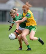 27 July 2019; Grace Kelly of Mayo in action against Deirdre Foley of Donegal during the TG4 All-Ireland Ladies Football Senior Championship Group 4 Round 3 match between Donegal and Mayo at Bord Na Mona O'Connor Park in Tullamore, Offaly. Photo by Ben McShane/Sportsfile