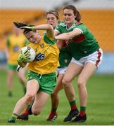 27 July 2019; Geraldine McLaughlin of Donegal is fouled by Ciara McManamon, right, and Danielle Caldwell of Mayo during the TG4 All-Ireland Ladies Football Senior Championship Group 4 Round 3 match between Donegal and Mayo at Bord Na Mona O'Connor Park in Tullamore, Offaly. Photo by Ben McShane/Sportsfile