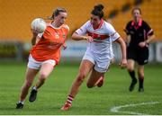 27 July 2019; Aoife McCoy of Armagh in action against Shauna Kelly of Cork during the TG4 All-Ireland Ladies Football Senior Championship Group 1 Round 3 match between Armagh and Cork at Bord Na Mona O'Connor Park in Tullamore, Offaly. Photo by Ben McShane/Sportsfile