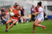 27 July 2019; Tiarna Grimes of Armagh in action against Shauna Kelly of Cork during the TG4 All-Ireland Ladies Football Senior Championship Group 1 Round 3 match between Armagh and Cork at Bord Na Mona O'Connor Park in Tullamore, Offaly. Photo by Ben McShane/Sportsfile