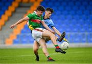 27 July 2019; Ruairí Keane of Mayo shoots to score his side's fourth goal of the game, despite pressure from Alex Watson of Dublin, during the Electric Ireland GAA Football All-Ireland Minor Championship Quarter-Final match between Mayo and Dublin at Glennon Brothers Pearse Park in Longford. Photo by Seb Daly/Sportsfile