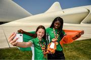 27 July 2019; Molly Mayne, left, and Rhasidat Adeleke of Ireland pose for a portrait with their 100m  and 200m breaststroke Bronze medals, and 100m, 200m Gold medals in front of the Heydar Aliyev Center in Baku during Day Six of the 2019 Summer European Youth Olympic Festival in Baku, Azerbaijan. Photo by Eóin Noonan/Sportsfile