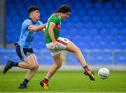27 July 2019; Rory Morrin of Mayo shoots to score his side's fifth goal of the game, despite presure from Oran Farrell of Dublin, during the Electric Ireland GAA Football All-Ireland Minor Championship Quarter-Final match between Mayo and Dublin at Glennon Brothers Pearse Park in Longford. Photo by Seb Daly/Sportsfile