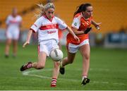 27 July 2019; Orla Finn of Cork in action against Megan Sheridan of Armagh during the TG4 All-Ireland Ladies Football Senior Championship Group 1 Round 3 match between Armagh and Cork at Bord Na Mona O'Connor Park in Tullamore, Offaly. Photo by Ben McShane/Sportsfile