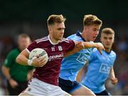 27 July 2019; Darragh Silke of Galway in action against Daire Newcombe of Dublin during the EirGrid GAA Football All-Ireland U20 Championship Semi-Final match between Galway and Dublin at Glennon Brothers Pearse Park in Longford. Photo by Seb Daly/Sportsfile