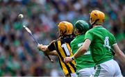 27 July 2019; Colin Fennelly of Kilkenny scores his side's first goal as Limerick defenders Seán Finn, centre, and Richie English close in during the GAA Hurling All-Ireland Senior Championship Semi-Final match between Kilkenny and Limerick at Croke Park in Dublin. Photo by Piaras Ó Mídheach/Sportsfile