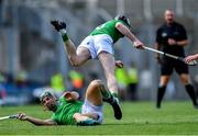 27 July 2019; Declan Hannon of Limerick trips over team-mate Seán Finn during the GAA Hurling All-Ireland Senior Championship Semi-Final match between Kilkenny and Limerick at Croke Park in Dublin. Photo by Piaras Ó Mídheach/Sportsfile
