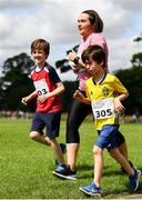 28 July 2019; Sinead Galvin with Max and Ben Lyons during the Athletics Ireland Festival of Running at Morton Stadium in Santry, Dublin. Photo by Sam Barnes/Sportsfile