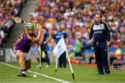 28 July 2019; Wexford manager Davy Fitzgerald watches Conor McDonald take a sideline cut during the GAA Hurling All-Ireland Senior Championship Semi Final match between Wexford and Tipperary at Croke Park in Dublin. Photo by Ramsey Cardy/Sportsfile