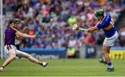 28 July 2019; Kevin Foley of Wexford blocks a shot by John O'Dwyer of Tipperary during the GAA Hurling All-Ireland Senior Championship Semi Final match between Wexford and Tipperary at Croke Park in Dublin. Photo by Ramsey Cardy/Sportsfile