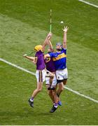 28 July 2019; John McGrath of Tipperary in action against Damien Reck of Wexford during the GAA Hurling All-Ireland Senior Championship Semi Final match between Wexford and Tipperary at Croke Park in Dublin. Photo by Daire Brennan/Sportsfile