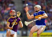 28 July 2019; Lee Chin of Wexford in action against Padraic Maher of Tipperary during the GAA Hurling All-Ireland Senior Championship Semi Final match between Wexford and Tipperary at Croke Park in Dublin. Photo by Ray McManus/Sportsfile