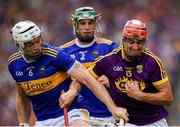 28 July 2019; Paul Morris of Wexford in action against Padraic Maher of Tipperary during the GAA Hurling All-Ireland Senior Championship Semi Final match between Wexford and Tipperary at Croke Park in Dublin. Photo by Ramsey Cardy/Sportsfile