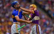 28 July 2019; Damien Reck of Wexford, right, in action against John McGrath of Tipperary during the GAA Hurling All-Ireland Senior Championship Semi Final match between Wexford and Tipperary at Croke Park in Dublin. Photo by Brendan Moran/Sportsfile