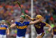 28 July 2019; John O'Dwyer of Tipperary in action against Damien Reck of Wexford during the GAA Hurling All-Ireland Senior Championship Semi Final match between Wexford and Tipperary at Croke Park in Dublin. Photo by Ramsey Cardy/Sportsfile