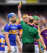 28 July 2019; John McGrath of Tipperary is shown a second yellow card by referee Sean Cleere, before being shown a red card, during the GAA Hurling All-Ireland Senior Championship Semi Final match between Wexford and Tipperary at Croke Park in Dublin. Photo by Ramsey Cardy/Sportsfile