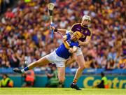 28 July 2019; Seamus Callanan of Tipperary is fouled by Wexford full back Liam Ryan during the GAA Hurling All-Ireland Senior Championship Semi Final match between Wexford and Tipperary at Croke Park in Dublin. Photo by Ray McManus/Sportsfile