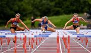 28 July 2019; Athletes from left, Lilly-ann O'Hora of Dooneen A.C., Co. Limerick, Molly Scott of St. Laurence O'Toole A.C., Co. Carlow, and Sarah Quinn of St. Colmans South Mayo A.C., Co. Mayo, competing in the Women's 100m Hurdles    during day two of the Irish Life Health National Senior Track & Field Championships at Morton Stadium in Santry, Dublin. Photo by Sam Barnes/Sportsfile