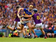 28 July 2019; Barry Heffernan of Tipperary is tackled by Kevin Foley, 8, and Liam Óg McGovern of Wexford during the GAA Hurling All-Ireland Senior Championship Semi Final match between Wexford and Tipperary at Croke Park in Dublin. Photo by Ray McManus/Sportsfile