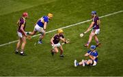 28 July 2019; Damien Reck of Wexford comes away with the ball before being struck by John McGrath of Tipperary, which resulted in McGrath getting a second yellow, and then a red card, during the GAA Hurling All-Ireland Senior Championship Semi Final match between Wexford and Tipperary at Croke Park in Dublin. Photo by Daire Brennan/Sportsfile