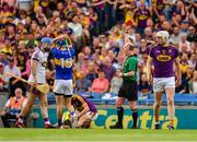 28 July 2019; John McGrath of Tipperary, 15, reacts as he is shown red card, second yellow, by referee Sean Cleere during the GAA Hurling All-Ireland Senior Championship Semi Final match between Wexford and Tipperary at Croke Park in Dublin. Photo by Ray McManus/Sportsfile