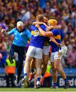 28 July 2019; Tipperary players, from left, Michael Breen, Niall O'Meara and Ronan Maher celebrate after the GAA Hurling All-Ireland Senior Championship Semi Final match between Wexford and Tipperary at Croke Park in Dublin. Photo by Brendan Moran/Sportsfile