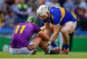 28 July 2019; Brendan Maher of Tipperary consoles Conor McDonald of Wexford after the GAA Hurling All-Ireland Senior Championship Semi Final match between Wexford and Tipperary at Croke Park in Dublin. Photo by Brendan Moran/Sportsfile
