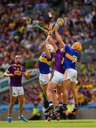 28 July 2019; Ronan Maher of Tipperary, his team mate Padraic Maher, and Conor McDonald of Wexford reach for the sliothar the GAA Hurling All-Ireland Senior Championship Semi Final match between Wexford and Tipperary at Croke Park in Dublin. Photo by Ray McManus/Sportsfile