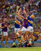 28 July 2019; Ronan Maher of Tipperary wins possession ahead of his team mate Padraic Maher and Conor McDonald of Wexford during the GAA Hurling All-Ireland Senior Championship Semi Final match between Wexford and Tipperary at Croke Park in Dublin. Photo by Ray McManus/Sportsfile