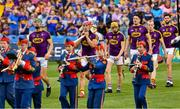 28 July 2019; Wexford joint captains, Matthew O'Hanlon, left, and Lee Chin, lead their players in the pre match parade before the GAA Hurling All-Ireland Senior Championship Semi Final match between Wexford and Tipperary at Croke Park in Dublin. Photo by Ray McManus/Sportsfile