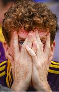 28 July 2019; A Wexford supporter watches the closing moments of the GAA Hurling All-Ireland Senior Championship Semi Final match between Wexford and Tipperary at Croke Park in Dublin. Photo by Brendan Moran/Sportsfile