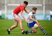 28 July 2019; Karl Gallagher of Monaghan in action against Jack Lawton of Cork during the Electric Ireland GAA Football All-Ireland Minor Championship Quarter-Final match between Monghan and Cork at Bord Na Mona O'Connor Park in Tullamore, Offaly. Photo by David Fitzgerald/Sportsfile