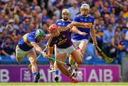 28 July 2019; Lee Chin of Wexford is dispossessed by Cathal Barrett of Tipperary during the GAA Hurling All-Ireland Senior Championship Semi Final match between Wexford and Tipperary at Croke Park in Dublin. Photo by Brendan Moran/Sportsfile