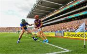 28 July 2019; Paul Morris of Wexford puts the sliotar through the legs of Cathal Barrett of Tipperary before going on to score a point during the GAA Hurling All-Ireland Senior Championship Semi Final match between Wexford and Tipperary at Croke Park in Dublin. Photo by Brendan Moran/Sportsfile