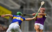 28 July 2019; Noel McGrath of Tipperary blocks a shot by Lee Chin of Wexford during the GAA Hurling All-Ireland Senior Championship Semi Final match between Wexford and Tipperary at Croke Park in Dublin. Photo by Brendan Moran/Sportsfile